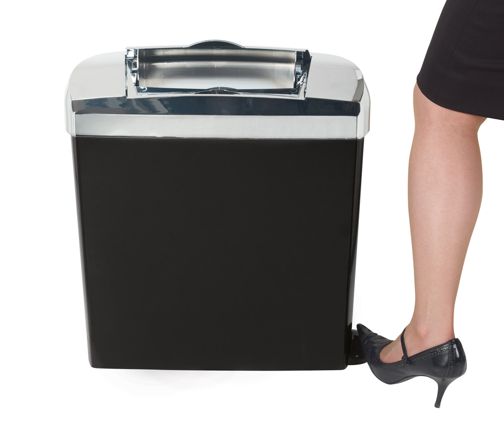 Lady operating the pedal on an Elite sanitary bin