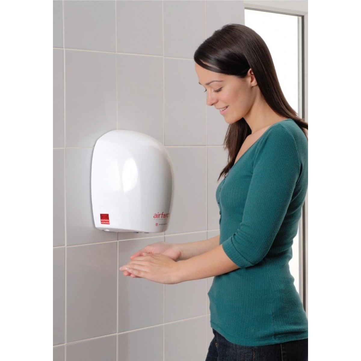 Lady using the economical Airforce Hand dryer in white