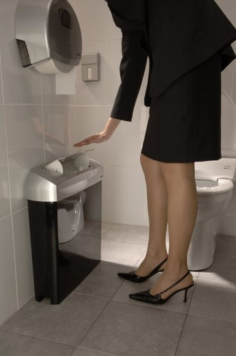 Sanitary bins: Lady displaying the auto touch opening