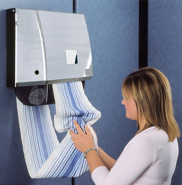 Linen roller towel dispenser being used by a lady